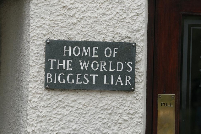 "Sign that says ""Home of the World's Biggest Liar."""